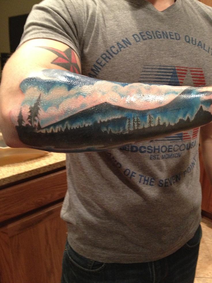 Mountain landscape tattoo