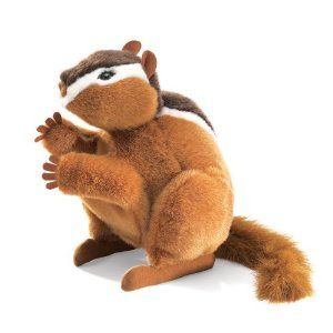 "Chipmunk Hand Puppet by Folkmanis. $13.92. Chubby cheeks, a ruddy complexion and racing stripes greet you when this friendly fellow climbs aboard your hand. Dimensions: 11"" long,	6"" wide, 11"" tall. When you work his arms, he can hold a nut or tidy his face up after dinner. Use your opposing hand to flick his tail for expressive gesturing. Amazon.com                An ancient Iroquois legend says Chipmunk got the stripes on his  back when angry Bear swatted at him,..."