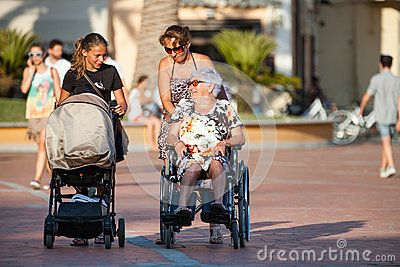 Disabled with wheelchair. Woman with pram. Women generation