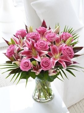 Fairtrade Hot Pink Rose and Lily Hand-tied -- everybody would love to get these tomorrow, right?    This beautiful bouquet is from interflora.co.uk