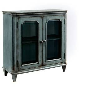 With its distressed vintage paint finish, fluted details and French provincial mouldings, this exquisite glass-front cabinet is sure to grace your space in such a très chic way. Adjustable shelved storage makes this versatile cabinet that much more practical. Signature Design by Ashley is a registered trademark of Ashley Furniture Industries, Inc.