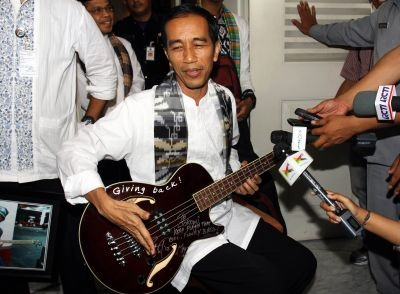 'The heavy metal-loving governor of Indonesian capital Jakarta has surrendered a guitar that was a gift from US band Metallica to anti-corruption authorities, an official said Tuesday.  A beaming Joko Widodo appeared on TV last week strumming the maroon bass guitar gifted to him by Metallicas Robert Trujillo, which was autographed and bore the words Giving Back!.. Keep Playin That Cool Funky Bass!.' And now become my mr President.