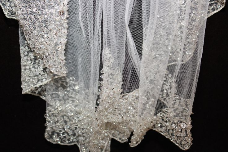 SALE!!! ONE IVORY READY TO SHIP AT WHOLESALE PRICE.....DONT MISS IT   New to our handmade collection - Exquisite one of a kind, beautiful handmade beaded edge veil with silver embroidery flat beading, flat crystal and beaded swarovski crystals.  stunning veil perfect for an elegant yet dazzling look. fingertip length 36 long x 72 wide on a metal comb  Made to order please allow 7-10 days to ship.   STUNNING CATHEDRAL AVAILABLE. 108 LONG X 72 WIDE. - - $379.99 approx 10-15 days prior to…