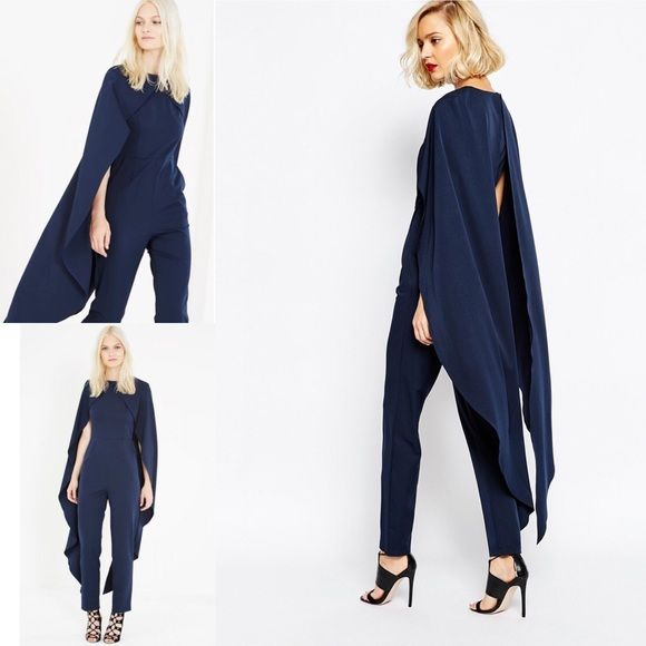 This gorgeous Lavish Alice navy jumpsuit features a maxi length cape. It's tailored cut and fitted waistline makes this ultra slimming jumpsuit screams designer.