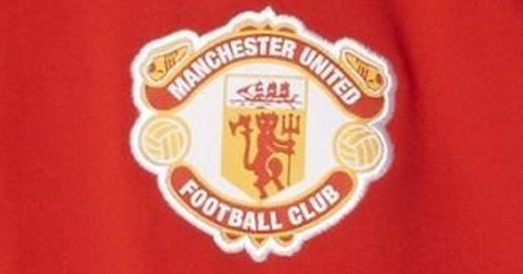 The badge now reads Manchester United Football Club - if you care to purchase any Adidas originals clothing.