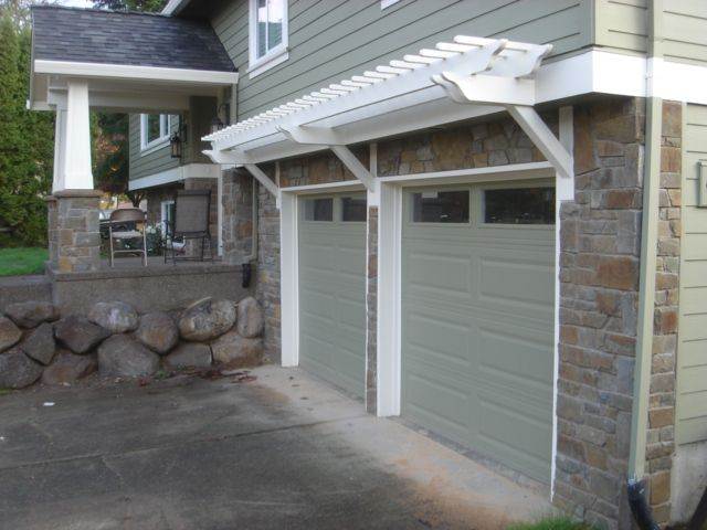 17 best images about bbm our projects stone veneer on for Wood veneer garage doors