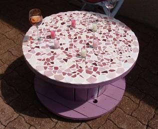 Make a mosaic top for that spool and have a great table.