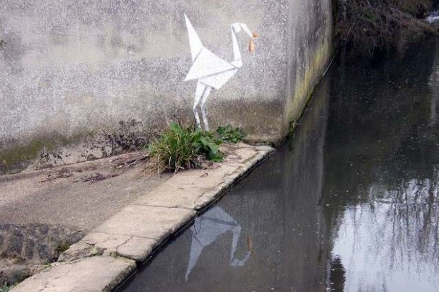 """""""New work by Banksy featuring an origami stork grabbing a fish from a canal has been seen in the UK."""" (via Saatchi Gallery"""