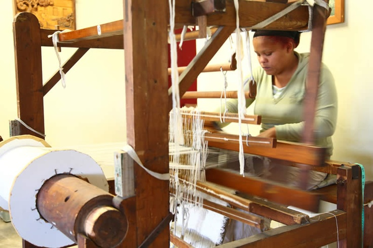 In the village of Barrydale in the Klein Karoo region, is a group of people weaving rugs and fabrics on wooden hand looms the old fashioned way.