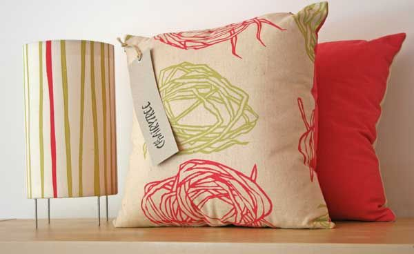 Screen printed cushions and lampshade. Image inspired by pandanus strips used for weaving in NT. Rolled/swirls and straight.