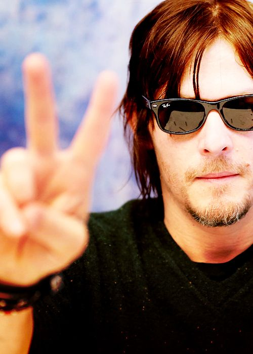 """PEACE / HE DOES HAVE MORE THAN 1 FINGER / A RARE PIC OF NORMAN WITHOUT HIS """"MIDDLE"""" FINGER RAISED"""