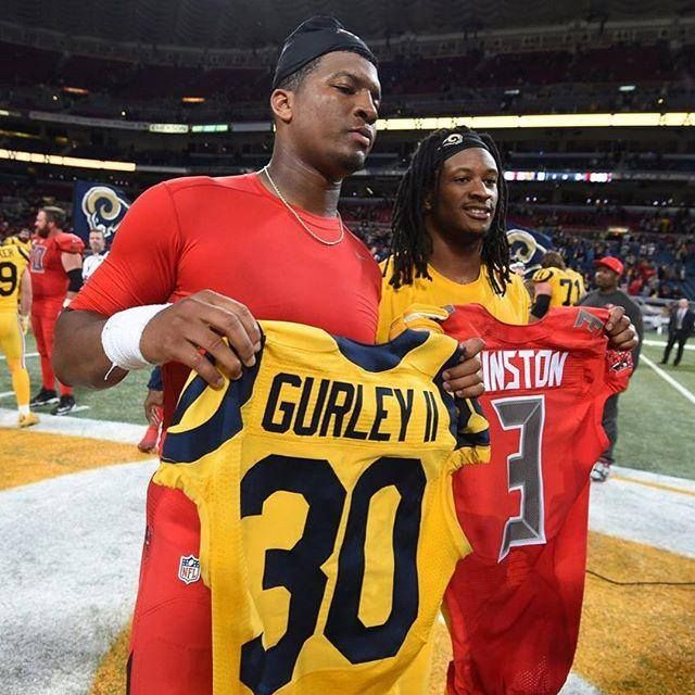 Jamies Winston and Todd Gurley swap jerseys after the Rams beat the Bucs on 12/17/2015.