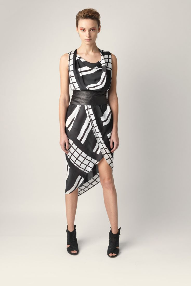 Flowing overlapped multicolor tunic Malloni. Soft neckline and deep front slit. Made of viscose.