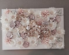 Flowers on Canvas - everything purchased from Michaels. Glue flowers with fabric glue onto canvas. Use multiple coats of white spray paint depending on the look you're going for. White acrylic paint (not watered down) works for those tough areas that won't take the spray paint. Choose *white* fake flowers if you are wanting a completely white look, as the darker colors will still show through the white spray paint.
