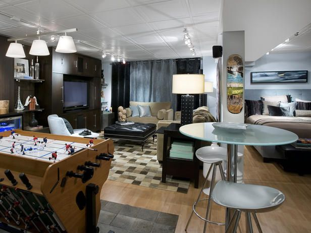 Cool Teen Hangout    For this basement makeover, Candice transformed an empty basement into a hip teen bedroom that also doubles as a family hangout. In the bedroom, she uses masculine shades of brown, blue and black