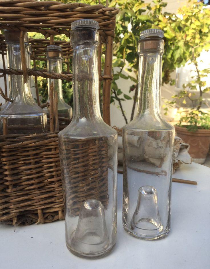 Antique small glass bottles in their wicker basket 19th French vintage de la boutique VintagedeFrance sur Etsy