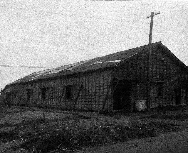 80-G-339281: Omori Prison Camp after liberation on 1 September 1945. Shown here is the outside of one of the POW buildings. Note the writing on the roof. Omori is one of Tokyo, Japan, biggest wards. Photograph received on 12 September 1945.