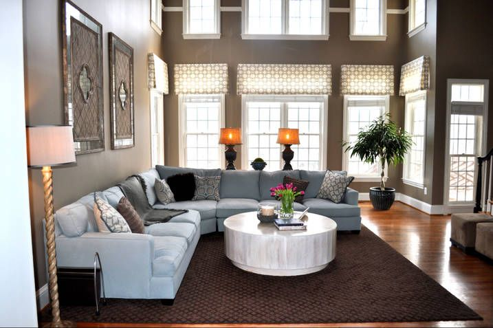 Window treatment for two story room.  Interesting use of molding on the upper windows