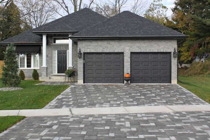 garage door, dark gray compliments house, front door could be bright