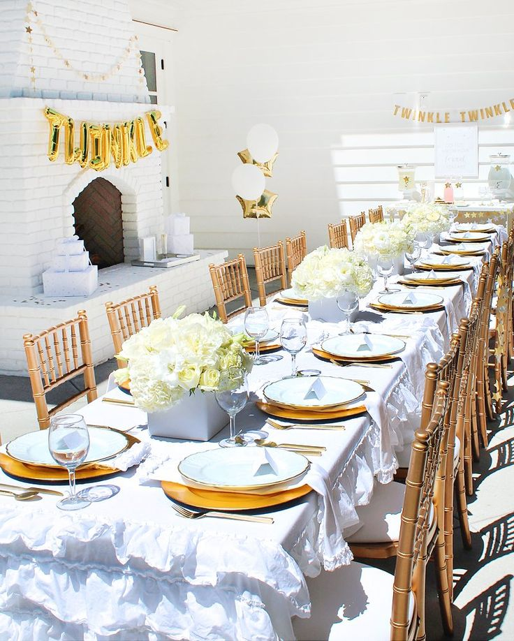 White floral centerpieces, gold chairs, and gold balloons are lovely touches for a chic shower.   A Glistening Guest Table   7 Twinkly Inspirations for a Wish Upon A Star Baby Shower