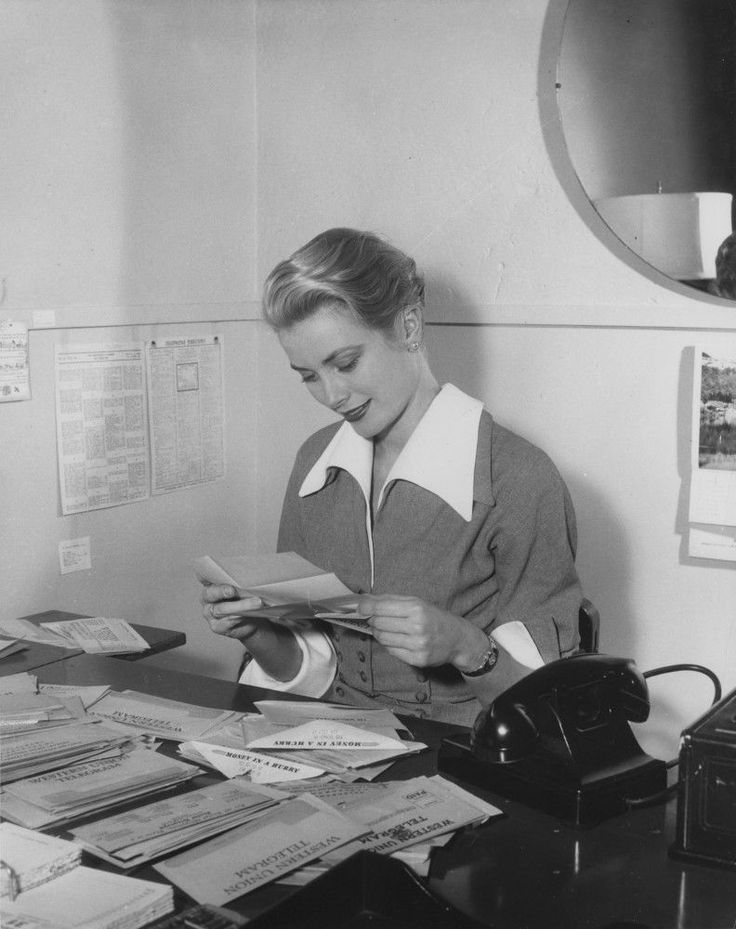 Grace & Family — Grace Kelly reading her fans' letters at her desk.