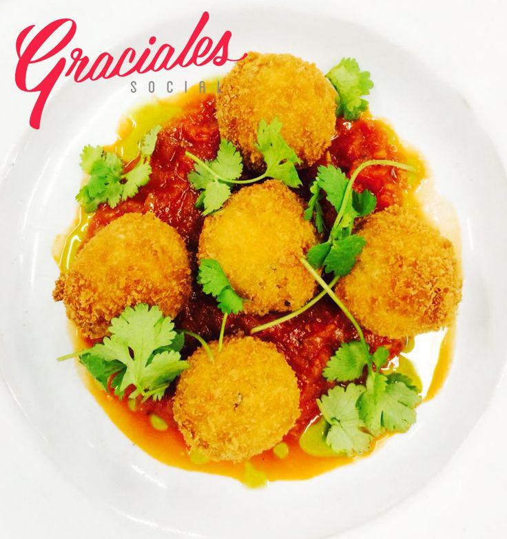 Panko crumbed fish balls in pomodoro sauce with fresh homegorwn coriander at Peddlars & Co.