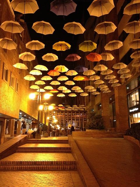 Sombrillas Colgantes en Bogotá, Colombia - by CAUT, via Flickr