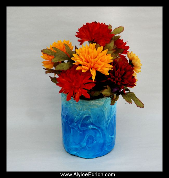 Alyice Edrich - circa 2012 - Art Jars - Mixed Media, tin cans, modeling paste, acrylic paints, fake flowers, glaze #tincans #recycledcans #alteredjars