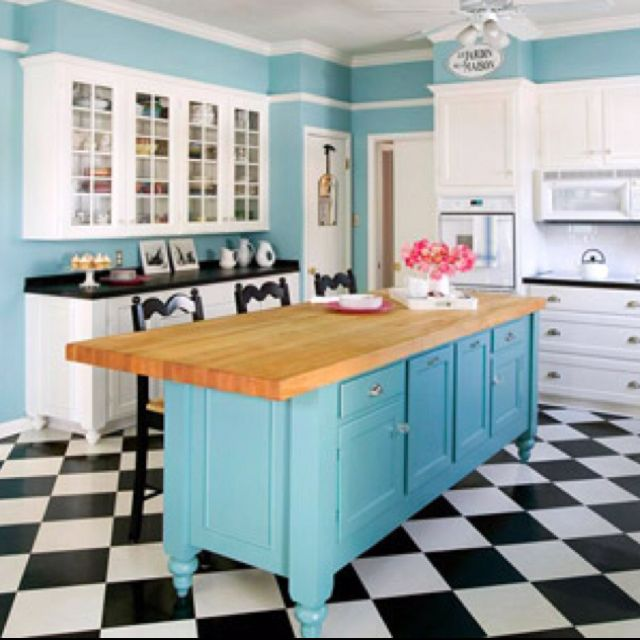 DIY Kitchen Island... Garage sale dresser, sand and paint, wood or marble top, add leg posts of choice and boom! Mini kitchen make over...though this is way too blue for me.