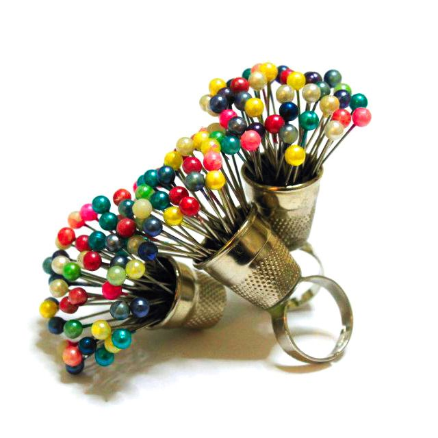 A pin bouquet ring for crafty ladies (Honestly, though, a tiny pincushion ring would be fantastic...)