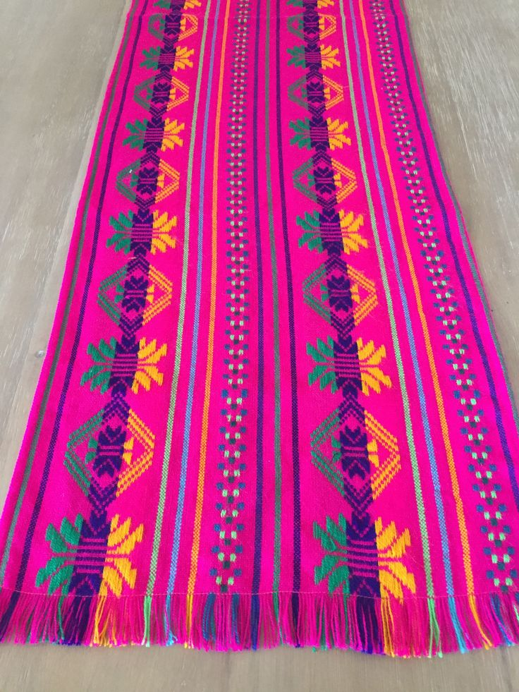 Beautiful folkloric Mexican colorful embroidered pink table runner! Great for your next Mexican themed party or Fiesta! Great quality fabric from Mexico. The ends have fringes for a more traditional l