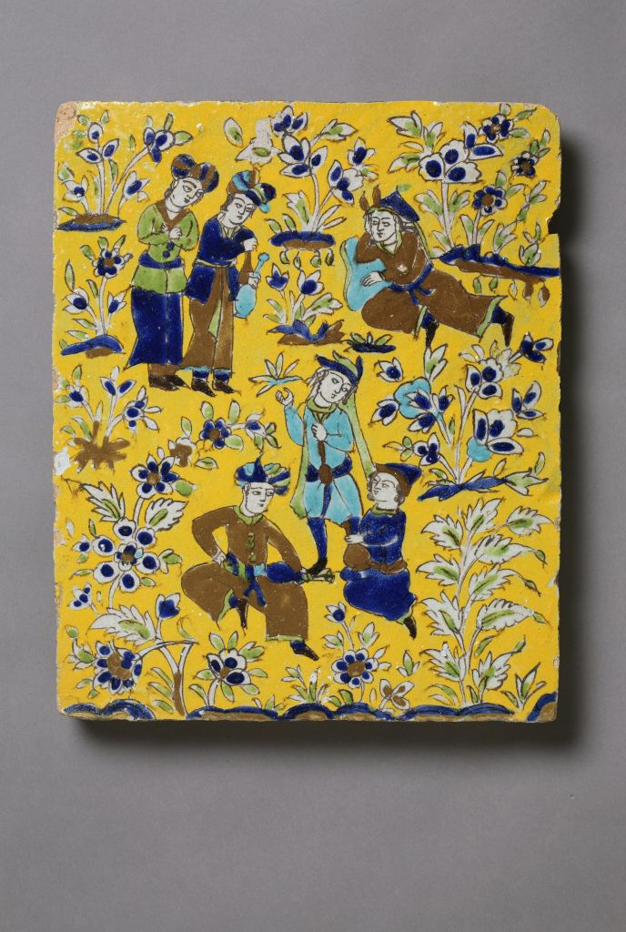 Iran, Isfahan province (Iranian), Tile with scene of figures in a garden, 17th century or later, stonepaste with polychrome decoration under clear glaze, in cuerda seca technique