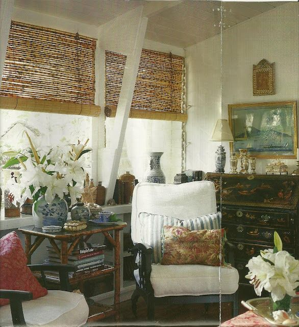 Pale cream walls, bamboo blinds & side table, ebony-finished arm chairs, blue/white pottery, chinoiserie writing desk... makes sense that a British Colonial room would also look like it belongs to someone who is well-traveled.