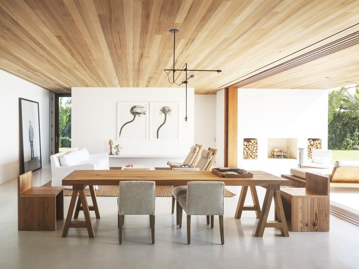 Gorgeous wood ceiling in dining space with wood table and benches