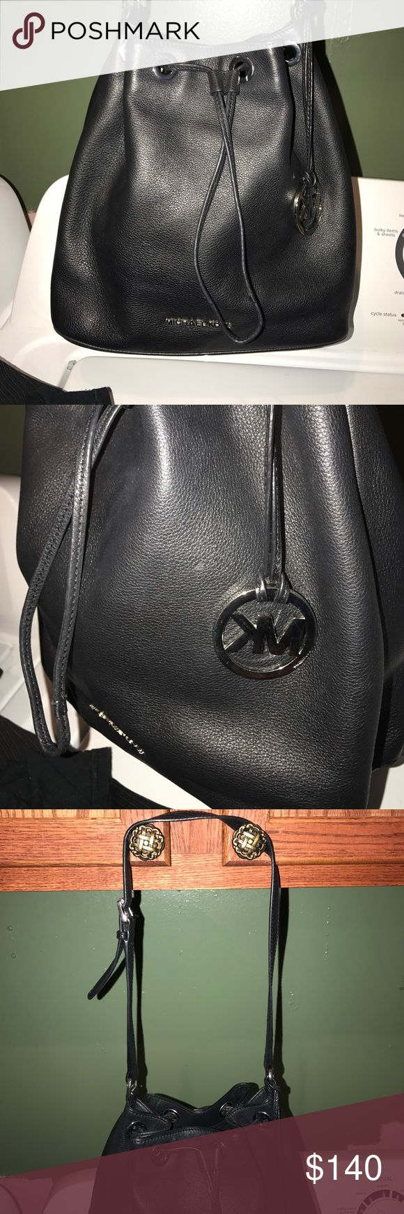"Michael kors bucket purse Beautiful black bucket bag with silver hard ware a few minor marks one on front a couple small on bottom included pictures. Good sized strap drop 15"" adjustable Michael Kors Bags Shoulder Bags"