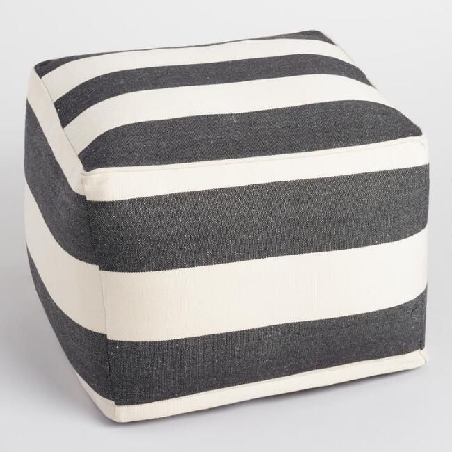 Ultra chic and oh-so-useful, our black and ivory striped pouf provides a soft footrest or additional seating for your family or guests wherever you need it. www.worldmarket.com #WorldMarket Outdoor