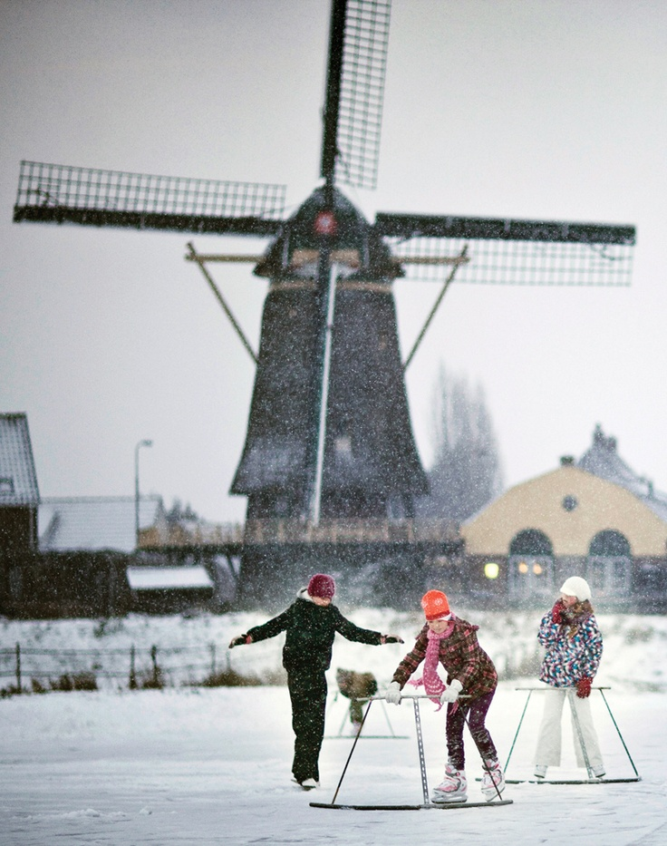 Winter in #Holland #windmill #snow #skating #Netherlands (Photo: Holland.com)