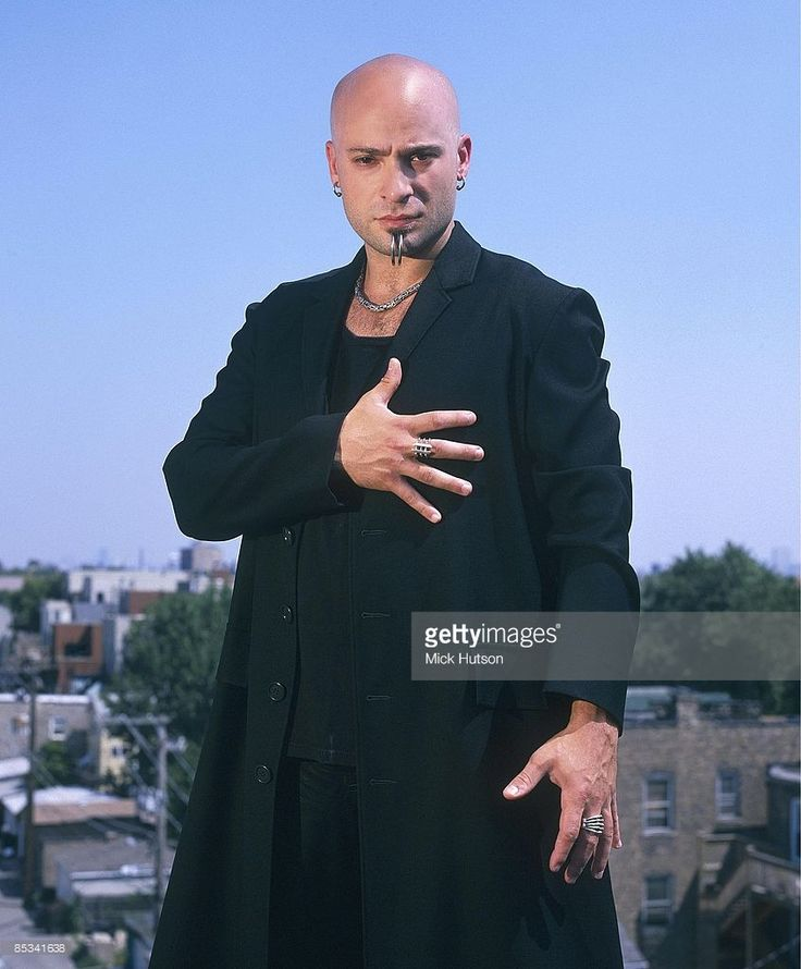 Photo of David DRAIMAN and DISTURBED; Posed portrait of David Draiman