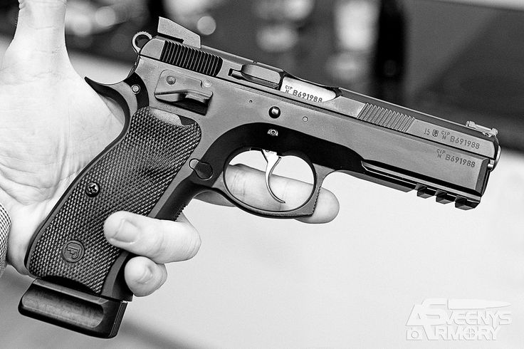 Black and White of a CZ75 SP-01 ShadowLoading that magazine is a pain! Get your Magazine speedloader today! http://www.amazon.com/shops/raeind