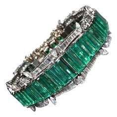 1950s one of a kind stunning platinum with 44 baguette cut muzo mine emeralds and diamonds bracelet