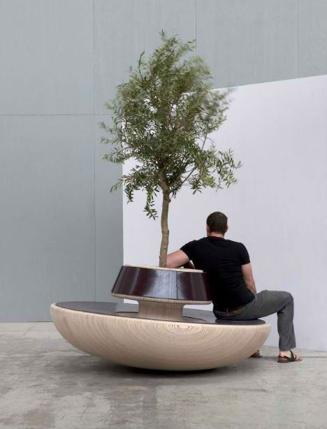 "Forcing strangers to interact in order to keep their balance, the 'CHITCHAT' public seating concept by Dutch designer Teun Fleskens encourages conversation with humor – and good looks. The seat for seven rocks back and forth on its rounded base. Says the designer, ""The ice is broken, the atmosphere has improved, and waiting has quickly become much less boring. The 'rocking trees' in the centre ensure a playful effect, especially when there are several CHITCHATS in a single space."""