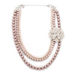 """Pink tone glass pearls join together tocreate this trendsetting jewelry set.  Gorgeous by day or night,showcasing a detachable crystal studded flower brooch on three glasspearl strands. 17"""" length plus a 3"""" chain extension Lobster claspDetachable brooch includedLead and nickel safe only $69.00"""