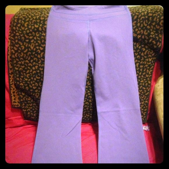 Lululemon Yoga Pants Hello Poshers!! I have this pair of Lulu lemon Yoga pant , beautiful lavender color gently worn, I don't really exercise so I have no use for them other to sleep in them lol  lululemon athletica Pants