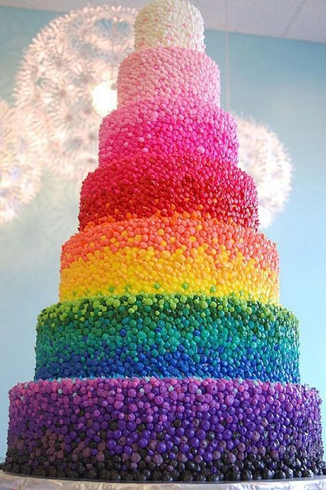 What a colourful cake, it's gorgeous !!!!!!!!!  That looks like an ombré style cake.  Had to take days to make!