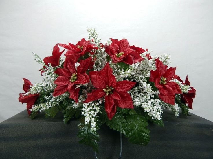 106 best ideas about tombstone saddles on pinterest for Poinsettia arrangements