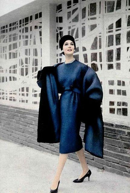 1958    Simone D'Aillencourt is wearing a blue wool ensemble by Pierre Balmain.