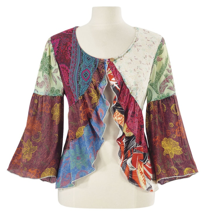 Imagine a spectrum of Indian cloth, patchworked into a jacket. Intriguing prints with exotic colors combine in this wonderful design—softly ruffled down its divided, front tiers, with a single, wood button-and-loop front closure