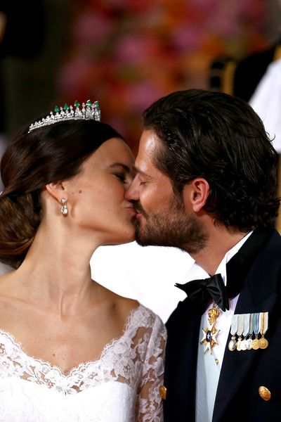 Prince Carl Philip Photos - Prince Carl Philip of Sweden kisses his new wife Princess Sofia of Sweden after their marriage ceremony on June 13, 2015 in Stockholm, Sweden. - Departures & Cortege: Wedding of Prince Carl Philip and Princess Sofia of Sweden