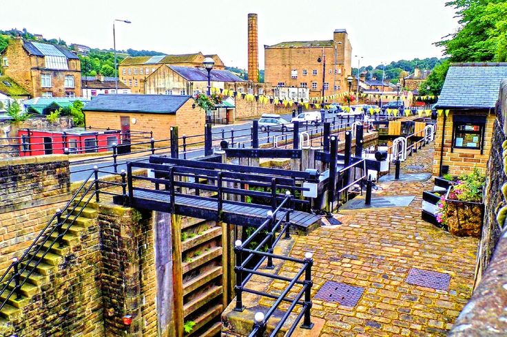 The lock was opened in 1996 as part of the Rochdale Canal restoration. The lock replaces locks 3 and 4 which were nearby but in filled during the 1950s. It is the deepest in land canal lock in the United Kingdom at 19 feet 8.5 inches. More of my pictures and information can be seen at, www.colingreenphotography.blogspot.co.uk