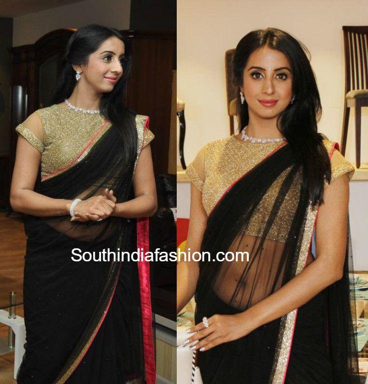 Sanjana in a black saree photo